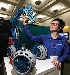 Qualcomm Inc., which displayed its Big Dragon Rover at a recent expo, sees opportunity in robotics.