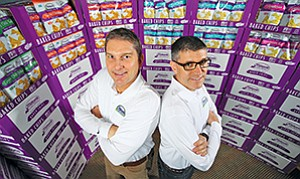 John Reaves, left, president and CEO of Milton's Baking Co., and Simon Kyne, president of marketing and innovation, stand in front of the company's baked chips, sold under the name Milton's Craft Bakers.