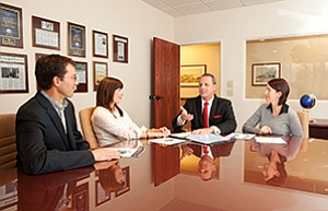 President Frank Reilly, second from right, discusses 2016 initiatives with members of his staff. From left, David Cariani, director of wealth management; Christina Dodge, senior vice president of marketing and special projects; Reilly; and Crystal Davila, Reilly's executive assistant.