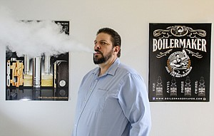 Blow Back: Owner Doug Hughes at Boilermaker Vapor, a vaping liquid distribution business in Torrance.