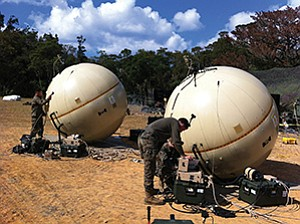 Photo courtesy of Cubic Corp. U.S. Marines work with two inflatable satellite dishes from GATR Technologies. San Diego-based Cubic Corp. plans to close its acquisition of Huntsville, Ala.-based GATR by the end of the month.