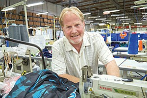 David Caserta, CEO of Teamwork Athletics Apparel, said the 'bread and butter' of the San Marcos business is still stock uniforms.