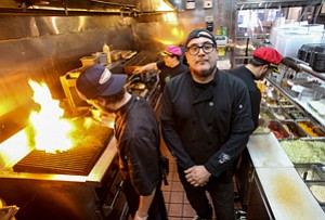 Feeling Heat: Marcus Christiana-Beniger, center, chef and co-owner at Little Jewel, a New Orleans-style bistro in Chinatown.