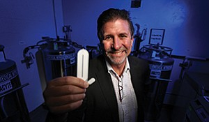 ViaCyte CEO Paul Laikind holds two thin capsules, one for humans, another for lab mice, that contain insulin-producing cells. The therapy could significantly alter the quality of life for people with type 1 diabetes.
