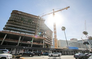 Going Up: Waldorf Astoria Beverly Hills hotel project, above, whose developers are seeking $150 million in foreign money.