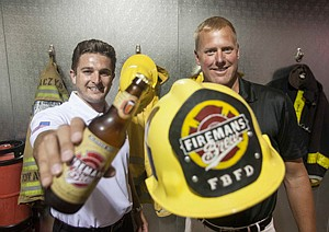 Tip of the Cap: David Johnson, left, and Robert Nowaczyk at the Canoga Park office of Fireman's Brew in a 2013 photo.