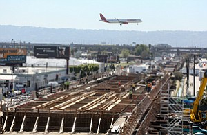 Getting on Track: Crew works on the LAX-Crenshaw rail line along Aviation Boulevard.