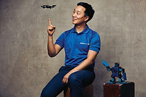 Hansol Hong shows off the CoDrone, a miniature drone designed to help young students learn about coding. Photo courtesy of Robolink Inc.