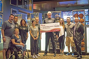 Bill Walton, center, and representatives of the Challenged Athletes Foundation accept a $50,000 donation presented by Sycuan Casino's general manager, John Dinius, right. Photo courtesy of Sycuan Casino