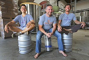 Left to right, Andrew Clark, Todd Kent, and Adam Hiner are the three founders of Boochcraft, a beverage company in Chula Vista that makes a kombucha 'beer' packed with an alcoholic punch.