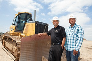 Cliff Smith Jr., right, and Steve Groves are building on the grading business founded by their father more than 50 years ago.