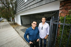 Owner Cameron Eghbali and broker Ash Joshi in front of soft-story apartment building.