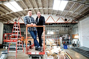 Celebrity chef and restaurateur Brian Malarkey (left) and business partner Christopher Puffer are seen here in December, preparing the space for their new venue in Little Italy, called Herb & Wood. Photo courtesy of Herb & Wood