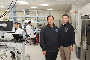 """Lab Fellows Co-Founders Julio de Unamuno IV, left, and Tim Ryan are trying to fill a need for lab space. Below, Suneer Jain of Sun Genomics Inc. works in Lab Fellows' downtown lab where he says he """"can focus on the science."""""""