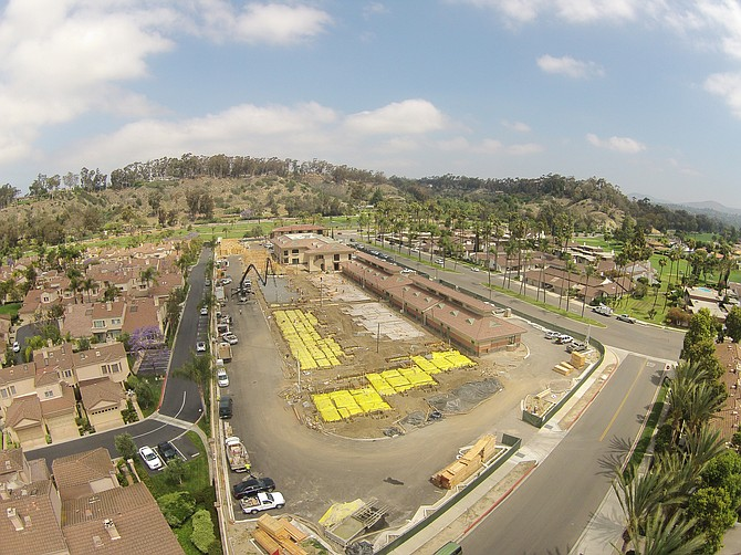 Apartments are under construction at the mixed-use Palma de la Reina in Rancho Santa Fe. -- Photo courtesy of Newport Pacific Inc.