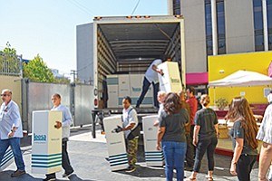 Volunteers at the San Diego Rescue Mission unload truckloads of new mattresses for use in its emergency shelters. Photo courtesy of San Diego Rescue Mission
