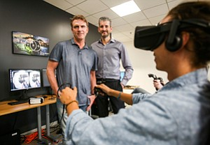 Hooked In: Robert Stromberg, left, and Chris Edwards at Mid-Wilshire's Virtual Reality Co., which raised $23 million this month and plans to develop feature films.