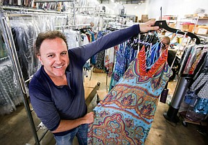 Dated Releases: Daniel Bohbot with dress at Hale Bob's factory near Rampart Village.
