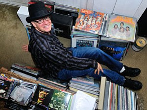 David Bash at his Sherman Oaks home with a music collection that includes 1,300 albums and more than 14,000 CDs.