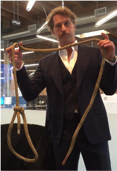 A photo included in the lawsuit of Brogan BamBrogan holding the noose allegedly left on his chair.