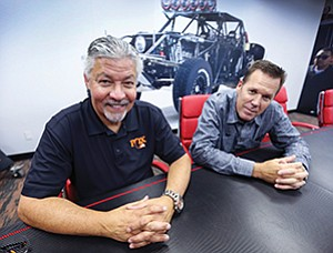 Tom Wittenschlaeger, vice president and general manager of the powered vehicles group at Fox Factory Holding Corp., left, and John Marking, corporate vice president for business innovation, have helped grow the El Cajon-based company by expanding its customer base.