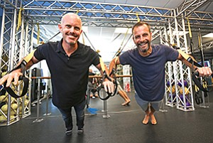 Lymber Co-Founders Doug Hecht, left, and Chuck Phillips try out a TRX at Cycology in Encinitas.