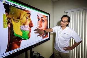 Dolphin Imaging's Chester Wang demonstrates graphics in Chatsworth.