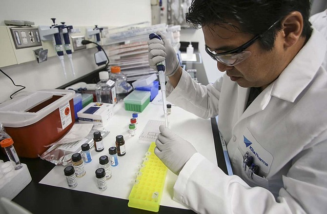 A Kite Pharma technician at work in its new El Segundo research lab.