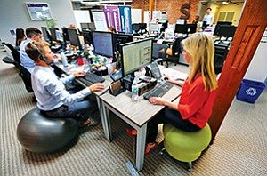 Stephanie LaMontagne, right, and Alan Mondus, left, work at DeskHub San Diego's coworking space in Little Italy.