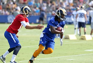 Fielding Offers: Rams QB Jared Goff, left, hands the ball to running back Todd Gurley.