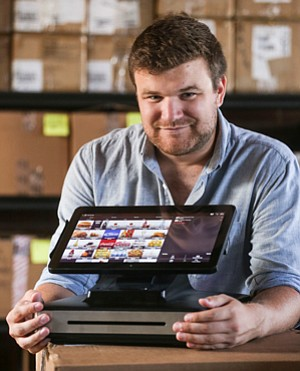 Stepping Up Sales: Max Roper with Appetize's in-stadium ordering device.