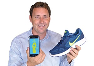 Sensors inside a running shoe, like the one UCSD's Don Sirbuly is holding, may be part of the next wave in wearable technology. Photo courtesy of SmartFoam