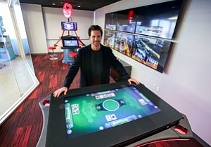Whole New Deal: Chief Executive Eric Meyerhofer with gambling video game at Gamblit Gaming's Glendale headquarters.