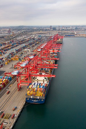 Navigating Uncertainty: Loaded cargo ships docked at the Port of Long Beach.