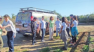 Students and teachers from Monroe Middle School wait to climb aboard a special Watershed Explorers Program van to explore the San Dieguito River Valley. Photo courtesy of Delle Willett