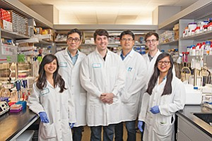 The Xycrobe team, Kristen Kuakini, from left, Mun Su Rhee, Thomas M. Hitchcock, Jeong Ho Kim, Blake Burchak and intern Lanchi Tran, are harnessing 'good' bacteria for use in skin treatments.