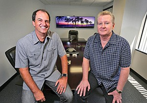 DecisionLogic's President David Evans, left, and CEO Carl Fredericks have developed software they say provides a more accurate picture of a borrower's ability to repay a loan.