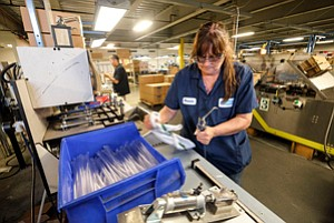 Clean Crew: Worker at Bobrick, which plans to stick with its zero-tolerance policy on drugs.