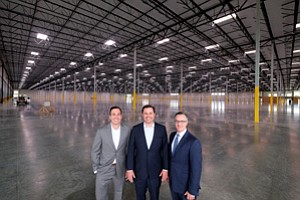 Huge Order: Ryan Collins, left, Bret Quinlan, and Greg Ames at the 1 million-squarefoot Brickyard facility in Compton.