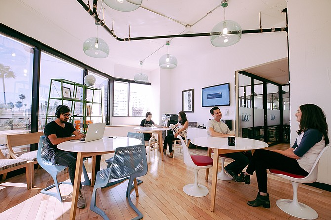 WeWork's shared office spaces are popular with tech startups, entrepreneurs, freelancers, and other remote workers. Photo depicts WeWork Los Angeles, courtesy of WeWork.