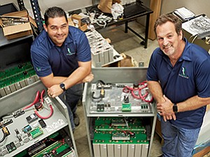 Raymond Trejo, left, and Walter Ellard manufacture cabinet-sized batteries