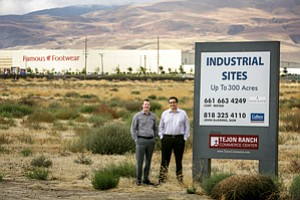 Visionaries: Cory Restad, left, and Hugh McMahon of Tejon Ranch Co. on new warehouse property.
