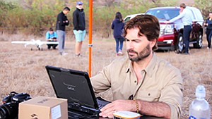 James Sheppard of the San Diego Zoo, top, consults a laptop computer during unmanned aircraft flight tests in late October. Northrop Grumman employees were asked to build an autonomous aircraft that could collect data on polar bears and their Arctic environment. Researchers will be looking for the wild cousins of the bear seen at the San Diego Zoo, below right. Photos courtesy of Northrop Grumman Corp.