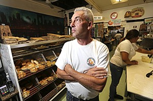 Steve Amster, owner of Garden State Bagels, said the cost of the city of Encinitas' ban on foam containers will be borne by businesses.