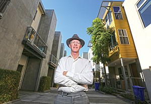 Realty advisor Gary London, shown here in his medium-density neighborhood downtown, sees townhomes as a promising solution to San Marcos' and the region's need for more housing.