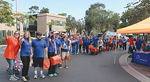 Volunteers from Outreach Impacting Lives gathered to distribute complete Thanksgiving meals to enlisted families in San Diego County. Photo courtesy of Outreach Impacting Lives