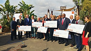 Mayor Kevin Faulconer, third from left, joins a group of San Diegans to celebrate $500,000 in donations to the Wells Fargo NeighborhoodLIFT program. Photo courtesy of Wells Fargo & Co.