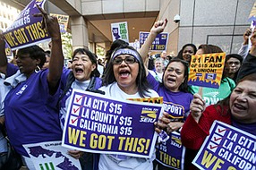 On the Money: Supporters of statewide wage increase celebrate.