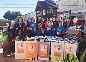Representatives from California Coast Credit Union and the San Diego County Office of Education deliver more than 7,000 socks raised during the Warm Their Soles sock drive to Home Start San Diego.  