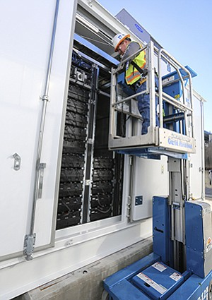 A union worker installs imported lithium-ion batteries at a SDG&E energy storage project.